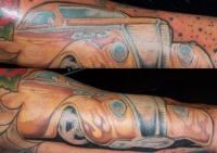 Oldsmobile in flames tattoo