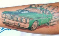 Green muscle car tattoo