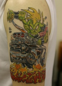 Green ork on hot rod coloured tattoo